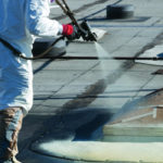 Applying Spray Foam Insulation on a Roof