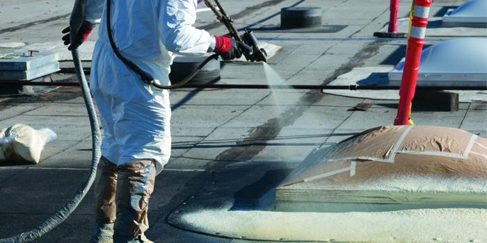 Applying Spray Foam Insulation on a Roof